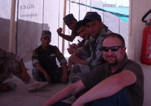 The author with Iraqi police recruits in Wasit province, 2008. Notice that you can see Chocolate Chip, Modified Chocolate Chip, a woodland pattern, and a guy with a white t-shirt. The dude flexing his muscle has on woodland camo pants with a different camo t-shirt.