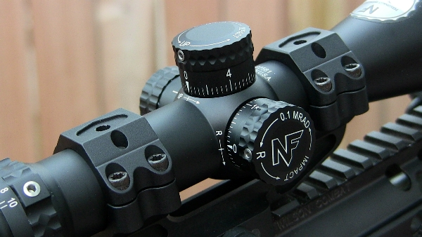 Nightfore 2.5-10x42 turret close up in Alamo Four Star DLOC mount